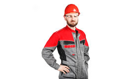 Man wearing overalls with red helmet Stock Photography