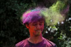Man Wearing Pink Crew-neck Shirt With Multicolored Powder stock photography