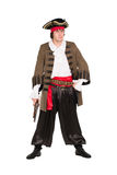 Man wearing pirate costume. Young man wearing pirate costume with a pistol. Isolated on white stock image