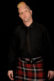 Man wearing plaid kilt Royalty Free Stock Photo