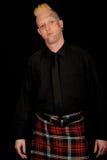 Man wearing plaid kilt royalty free stock photo