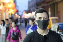 Man wearing pollution mask outdoors royalty free stock photos