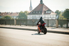 Man wearing protective clothes and helmet on a Ducatti motorcycl Royalty Free Stock Photos