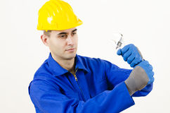 Man holding Adjustable Wrench Stock Photos