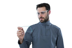 Man wearing protective eyewear holding a glass sheet Stock Photos