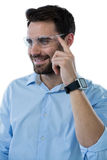 Man wearing protective eyewear and smart watch Royalty Free Stock Photography
