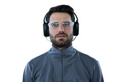 Man wearing protective glasses listening to headphones Royalty Free Stock Photo