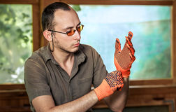 Man wearing protective gloves Stock Photography