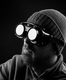Man wearing protective goggles. Over black background royalty free stock photo