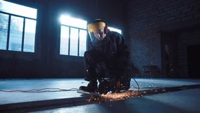 Workman angle grinding in protective clothing stock video