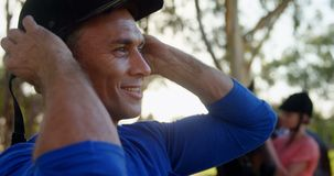 Man wearing protective helmet 4k. Man wearing protective helmet in ranch 4k stock video footage