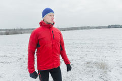 Man wearing protective sport jacket before his winter training session. Outdoors Stock Photos
