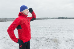 Man wearing protective sport jacket starting his winter training session. Man wearing protective sport jacket is starting his winter training session Stock Image