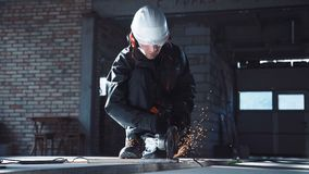Man cutting with angle grinder stock footage