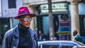 Man Wearing Purple Hat and Black Leather Jacket royalty free stock images