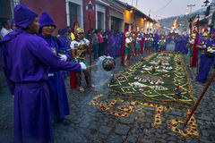 Man wearing purple robes and ancient Roman military clothes during the Easter celebrations, in the Holy Week, in Antigua, Guatemal. Antigua, Guatemala - April 17 Stock Photos