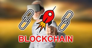 Man wearing a reality virtual headset touching a blockchain success concept on a touch screen. With his finger Royalty Free Stock Photography