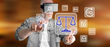 Man wearing a reality virtual headset touching a business compliance on a touch screen. With his fingers Stock Photos