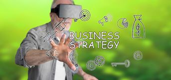 Man wearing a reality virtual headset touching a business strategy concept on a touch screen. With his finger Royalty Free Stock Image