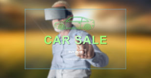 Man wearing a reality virtual headset touching a car sale concept on a touch screen Stock Images