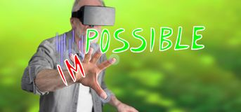 Man wearing a reality virtual headset touching a challenge concept on a touch screen. With his finger Stock Photos