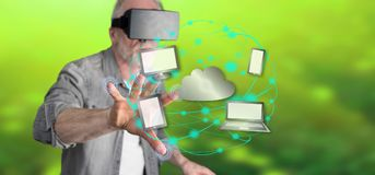 Man wearing a reality virtual headset touching a cloud computing concept on a touch screen. With his finger Royalty Free Stock Photo