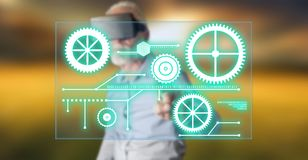 Man wearing a reality virtual headset touching a digital technology concept on a touch screen Stock Photo