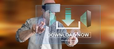 Man wearing a reality virtual headset touching a download concept on a touch screen. With his fingers Royalty Free Stock Photo