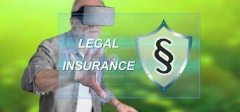 Man wearing a reality virtual headset touching a legal insurance concept on a touch screen Stock Images
