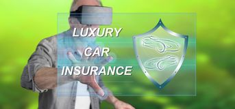 Man wearing a reality virtual headset touching a luxury car insurance concept on a touch screen Stock Image