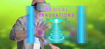 Man wearing a reality virtual headset touching a medical innovation concept on a touch screen. With his finger Stock Image