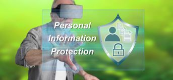 Man wearing a reality virtual headset touching a personal information protection concept on a touch screen. With his finger Stock Images