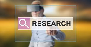 Man wearing a reality virtual headset touching a research concept on a touch screen Stock Image