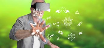 Man wearing a reality virtual headset touching share symbols on a touch screen Stock Image