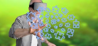 Man wearing a reality virtual headset touching a teamwork concept on a touch screen Royalty Free Stock Photo
