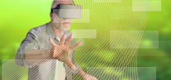 Man wearing a reality virtual headset touching a virtual technology concept on a touch screen. With his finger royalty free stock photography
