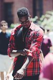 Man Wearing Red Black and White Plaid Dress Shirt and Brown Sunglasses in Macro Photography Stock Photography