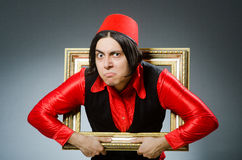 The man wearing red fez hat Stock Photo