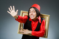 Man wearing red fez hat Stock Photo