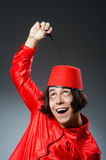 Man wearing red fez hat Royalty Free Stock Images