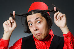 Man wearing red fez hat Stock Photography