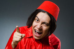 The man wearing red fez hat Royalty Free Stock Photo