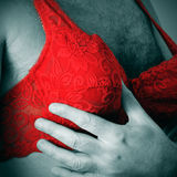 A man wearing a red lace bra Stock Images
