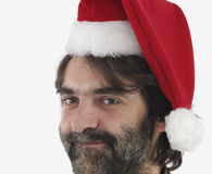 Man wearing red Santa hat Royalty Free Stock Image