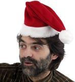 Man wearing red Santa hat Stock Photography