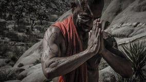 Man Wearing Red Scarf Praying Stock Image