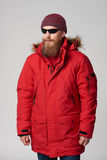 Man wearing red winter Alaska jacket  with fur hood on Royalty Free Stock Photography
