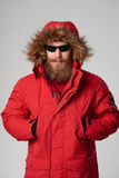 Man wearing red winter Alaska jacket  with fur hood on Royalty Free Stock Photos