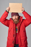 Man wearing red winter Alaska jacket  with fur hood on Royalty Free Stock Photo