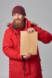 Man wearing red winter Alaska jacket  with fur hood on Royalty Free Stock Photos